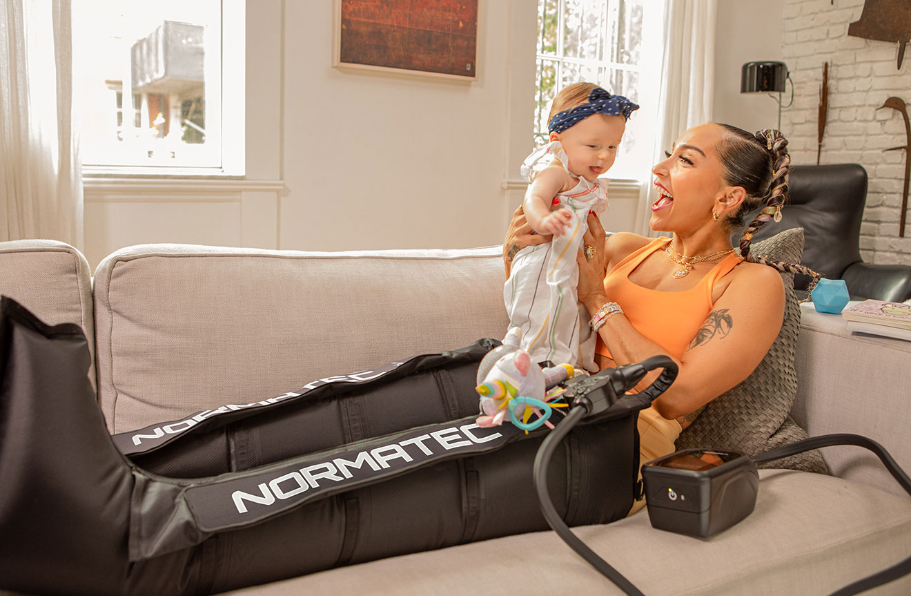 Robin Arzon using the Normatec legs